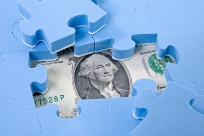 11454886-hidden-assets-puzzle-pieces-on-dollar-background