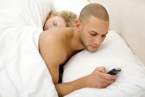 80113958-young-man-text-messaging-with-young-woman-gettyimages